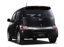 Фото авто Subaru Dex 1 поколение, ракурс: 135 цвет: черный