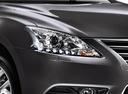 Фото авто Nissan Sentra B17, ракурс: задние фонари цвет: черный