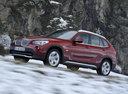 Фото авто BMW X1 E84, ракурс: 45 цвет: красный