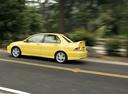 Фото авто Mitsubishi Lancer IX, ракурс: 90 цвет: желтый