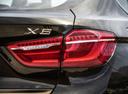 Фото авто BMW X6 F16, ракурс: задние фонари цвет: коричневый