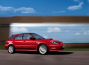 Фото авто Subaru Impreza 2 поколение [2-й рестайлинг], ракурс: 270 цвет: красный