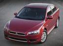 Фото авто Mitsubishi Lancer X, ракурс: 45 цвет: красный