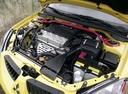 Фото авто Mitsubishi Lancer IX, ракурс: двигатель цвет: желтый