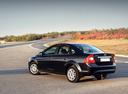 Фото авто Ford Focus 2 поколение [рестайлинг], ракурс: 135 цвет: черный