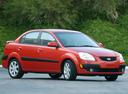 Фото авто Kia Rio 2 поколение, ракурс: 315 цвет: красный
