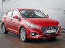 Фото авто Hyundai Solaris 2 поколение, ракурс: 315 цвет: красный