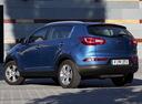 Фото авто Kia Sportage 3 поколение, ракурс: 135 цвет: голубой