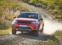 Фото авто Land Rover Discovery Sport 1 поколение, ракурс: 45 цвет: оранжевый