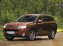 Фото авто Mitsubishi Outlander 3 поколение, ракурс: 45 цвет: оранжевый