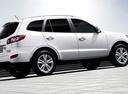 Фото авто Hyundai Santa Fe CM [рестайлинг], ракурс: 270 цвет: белый