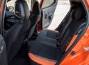 Фото авто Nissan Micra K14, ракурс: задние сиденья цвет: оранжевый