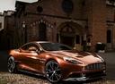 Фото авто Aston Martin Vanquish 2 поколение, ракурс: 315 цвет: оранжевый