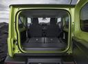 Фото авто Suzuki Jimny 4 поколение, ракурс: багажник цвет: зеленый