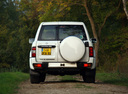 Фото авто Nissan Patrol Y61, ракурс: 180 цвет: белый
