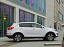 Фото авто Kia Sportage 3 поколение, ракурс: 270 цвет: белый