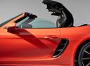 Фото авто Porsche Boxster 982, ракурс: боковая часть цвет: оранжевый