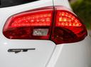 Фото авто Kia Cee'd 2 поколение, ракурс: задние фонари цвет: белый