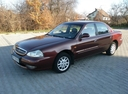 Фото авто Kia Clarus 1 поколение [рестайлинг], ракурс: 45