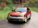 Фото авто Subaru Outback 2 поколение, ракурс: 45 цвет: красный