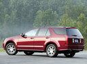 Фото авто Cadillac SRX 1 поколение, ракурс: 135 цвет: красный