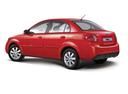 Фото авто Kia Rio 2 поколение [рестайлинг], ракурс: 135 цвет: красный