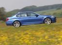 Фото авто BMW M5 F10, ракурс: 270 цвет: синий