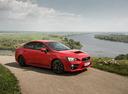 Фото авто Subaru Impreza 4 поколение [рестайлинг], ракурс: 315 цвет: красный