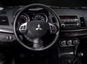 Фото авто Mitsubishi Lancer X, ракурс: рулевое колесо