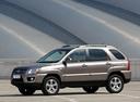 Фото авто Kia Sportage 2 поколение [рестайлинг], ракурс: 45 цвет: серебряный