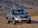 Фото авто Skoda Yeti 1 поколение, ракурс: 315 цвет: серебряный