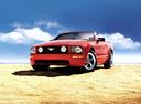 Фото авто Ford Mustang 5 поколение, ракурс: 45 цвет: красный