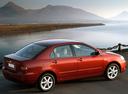 Фото авто Toyota Corolla E120, ракурс: 225 цвет: красный