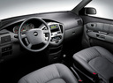 Фото авто Kia Carens 2 поколение, ракурс: торпедо