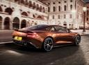 Фото авто Aston Martin Vanquish 2 поколение, ракурс: 225 цвет: оранжевый