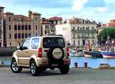 Фото авто Suzuki Jimny 3 поколение [рестайлинг], ракурс: 135 цвет: сафари