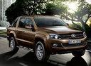 Фото авто Volkswagen Amarok 1 поколение, ракурс: 315 цвет: коричневый