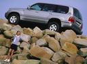 Фото авто Toyota Land Cruiser J100, ракурс: 90 цвет: серебряный