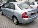 Фото авто Kia Cerato 1 поколение, ракурс: 135 цвет: серебряный