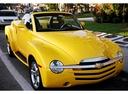 Фото авто Chevrolet SSR 1 поколение, ракурс: 315 цвет: желтый