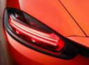 Фото авто Porsche Boxster 982, ракурс: задние фонари цвет: оранжевый