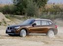 Фото авто BMW X1 E84, ракурс: 45 цвет: коричневый
