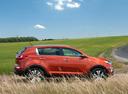 Фото авто Kia Sportage 3 поколение, ракурс: 270 цвет: оранжевый