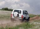 Фото авто ТагАЗ Tager 1 поколение, ракурс: 180 цвет: белый