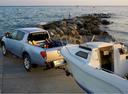 Фото авто Mitsubishi L200 4 поколение [рестайлинг], ракурс: 135 цвет: серебряный