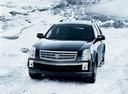 Фото авто Cadillac SRX 1 поколение, ракурс: 45 цвет: черный