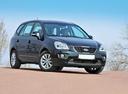Фото авто Kia Carens 3 поколение [рестайлинг], ракурс: 315 цвет: черный