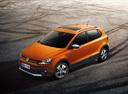 Фото авто Volkswagen Polo 5 поколение, ракурс: 45 цвет: оранжевый