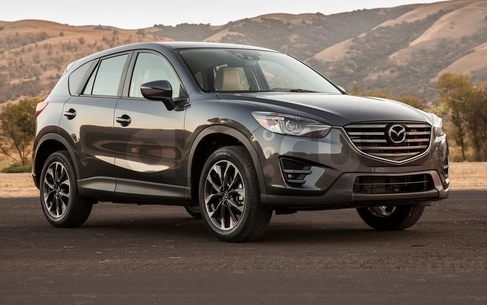 Подержанный Mazda CX-5, хорошее состояние, коричневый металлик, 2015 года выпуска, цена 1 400 000 руб. в Ульяновске
