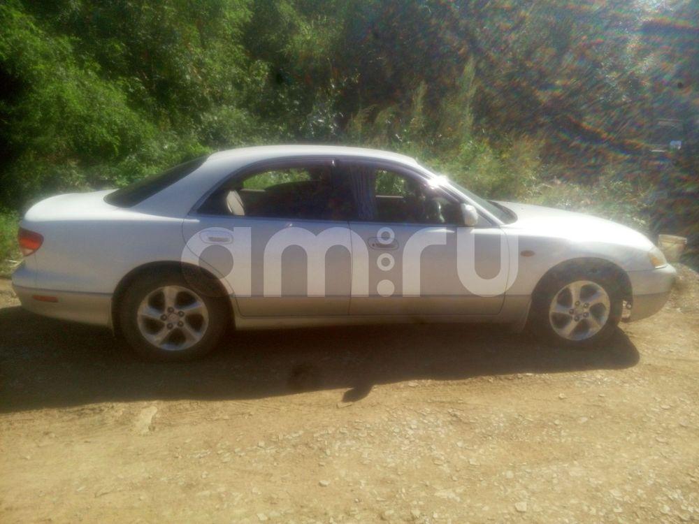 Подержанный Mazda Millenia, хорошее состояние, белый перламутр, 2001 года выпуска, цена 175 000 руб. в Владивостоке